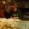 Tony Franklin '13 and manager Maddie Lesser '13 prepare a turkey for the closing weekend Thanksgiving feast.