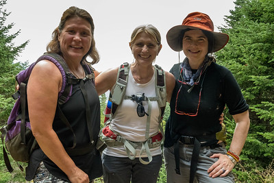 Becky Todd '84, Sue Fernyak '84, and Viva Hardigg '84, on the Gorge Brook trail up Moosilauke.