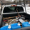 Lodge starter pack: water, trailwork tools, and maple syrup