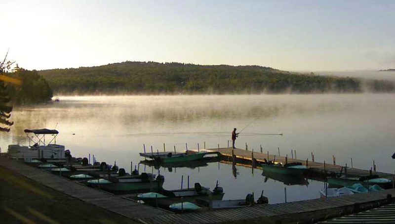 Early riser fishing off the Tall Timber dock.