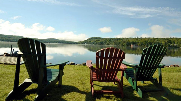 Relax by the lake at Tall Timber Lodge.