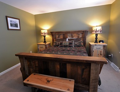 Master Bedroom in Syd's Cabin. Tall Timber cabin rental in Pittsburg, NH.