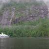 Sole yacht at anchor under the big granite cliffs at PLI.