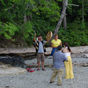 A song of welcome for a visiting film crew on the beach at Halfway, Sechelt Inlet.