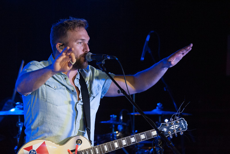 "Logan Mize sings during a performance at The Hat in Manhattan, Kansas on Nov. 3, 2018. Mize is from Clearwater, Kansas and released his most recent album ""Come Back Road"" in 2017. (Photo by Justin Wright 