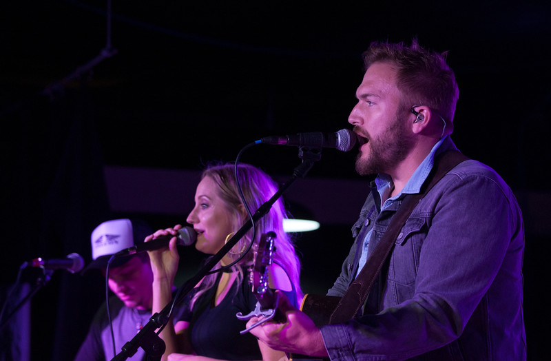 Jill and Logan Mize sing a duet during a performance at The Hat in Manhattan, Kansas on Nov. 3, 2018. Jill will open for her husband Logan Mize when she joins him on his tours. (Photo by Justin Wright | Collegian Media Group)
