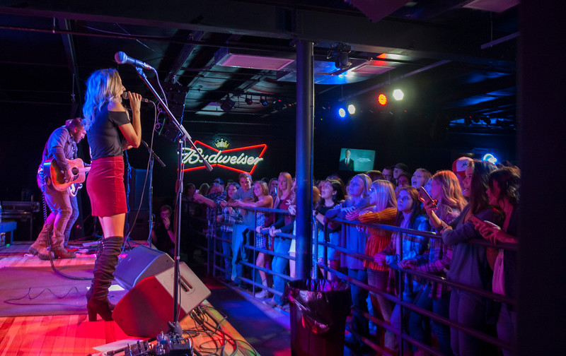 Jill Mize sings while being backed up by Logan Mize and his band during a performance at The Hat in Manhattan, Kansas on Nov. 3, 2018. Jill will open for her husband Logan Mize when she joins him on his tours. (Photo by Justin Wright | Collegian Media Group)