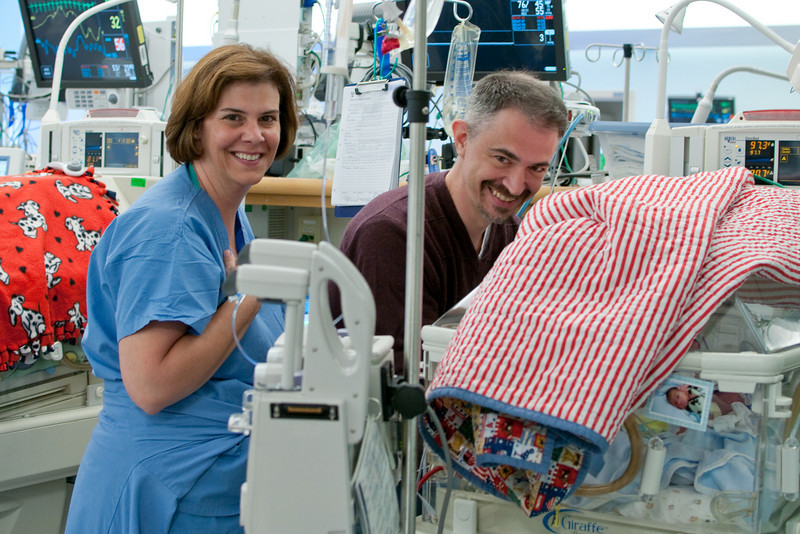 Day 25. Changing Logan with an assist from Norma, a wonderful and kind nurse.