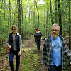 Lunenburg residents have spoken out about forest management/logging plans and on Thursday they took a walk in Small Town Forest to show why they are concerned. From left is Carol Hunt, Sharon Lane and Paul Hunt on one of the trails that has not been touched by the logging. SENTINEL & ENTERPRISE/JOHN LOVE