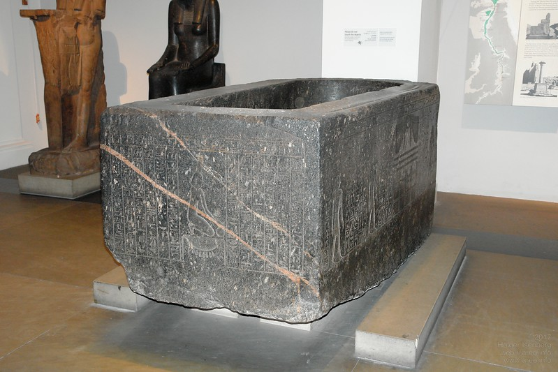 Egyptian granite sarcophagus of Hapmen with obvious traces of plasticine like stone during construction on the upper edges. British Museum.