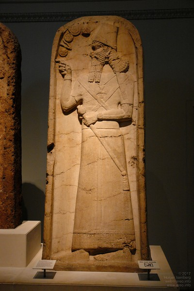 British Museum. 2800 year-old stele of Shamshi Adad from Assyrian capital Nimrud. The unusual cross symbol for that time was later used by the Knight Templars. The wristwatch is temporary standard gear for all gods and rulers.