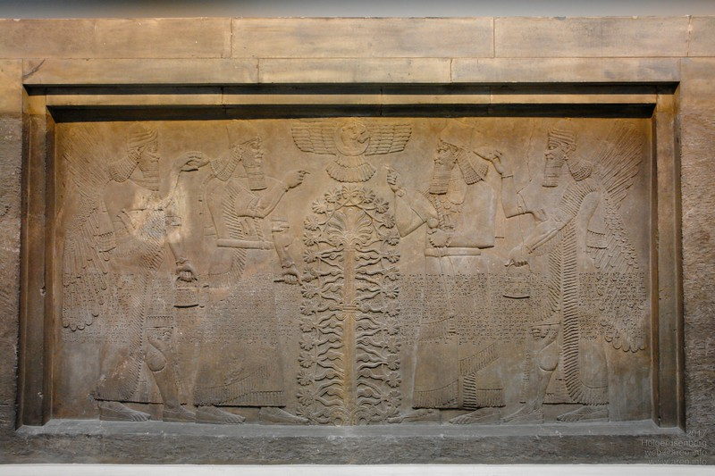 "Assyrian king Ashurnasirpal from Nimrud with protective ""gods"" working on the the tree of life which looks suspiciously like the DNA double helix. Again all with their standard gear: wings, two wristwatches, utility case. British Museum."
