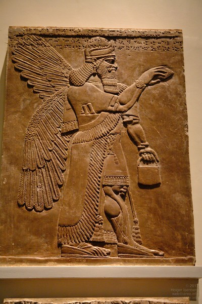 British Museum. A deity can easily be identified on Assyrian stelae from Nimrud by their wings, two wristwatches and a small utility case or a Panasonic Toughbook CF-29.