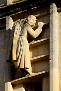 Angel climbing the ladder to heaven.  Outside of the abbey in Bath.