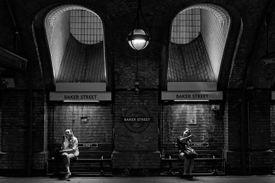 Killing time at Baker Street tube station (b/w)