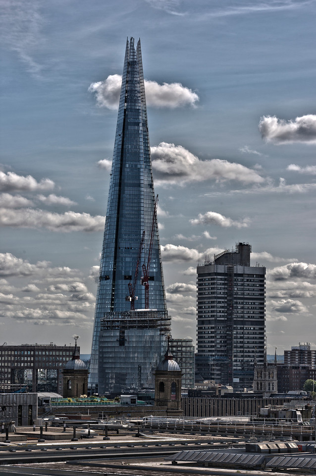 View of The Shard and Guys Hospital near London Bridge railway station. The view is take from near St Paul's Cathedral. HDR and other post processing techniques have been applied to this photo to create the unusual arty effect.