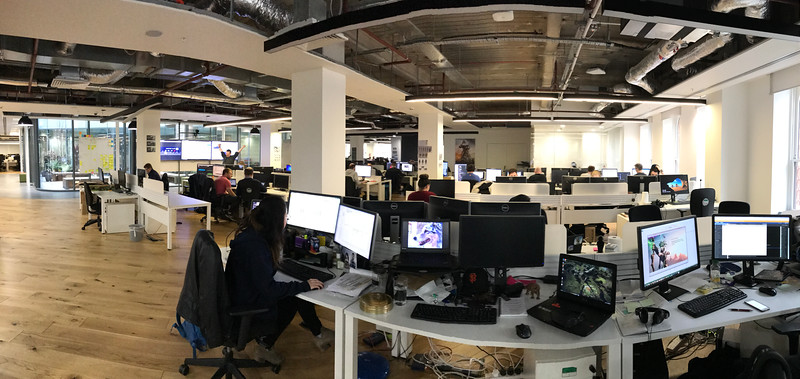 An indoor panoramic shot I took from behind my desk, the one in the middle. I think that's Clark on my monitor.