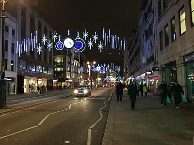 Just down the street is the major road through Covent Garden where our office is. There's a ton of restaurants, stores, and a couple of theaters.  They've strung up the holiday lights!
