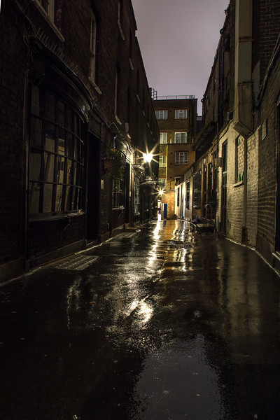 Old Victorian backstreet with old fashioned street lamps in Covent Garden