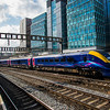 A Frist Great Western Class 180 DMU set departs from London Paddington.