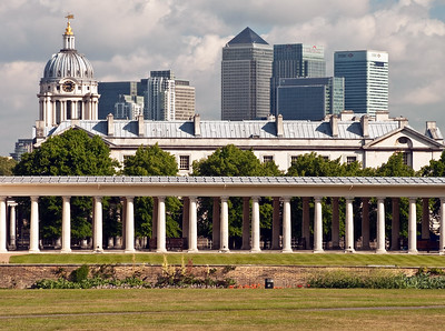 The offices of Canary Wharf framed by Queen Anne House in Greenwich Park