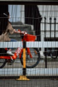 Masked biker through a fence