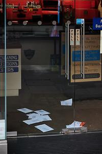 Mail pileup at a closed-up store
