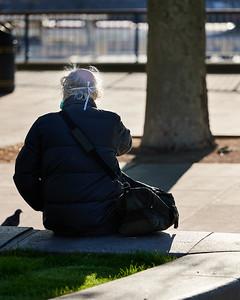 Elderly masked man with random pigeon silhouette