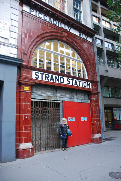 Liz stands outside the old entrance to the Aldwych on the Strand