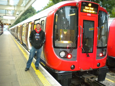 Pic by Liz   Ghost Station Man   stands next to the back coach of the   Service tain that brought us in from   Baker street