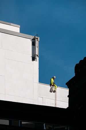 Worker on the side of a building in London