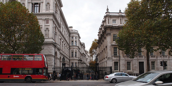 "10 Downing Street, colloquially known in the United Kingdom as ""Number 10"", is the headquarters of Her Majesty's Government and the official residence and office of the First Lord of the Treasury, an office now invariably held by the Prime Minister."