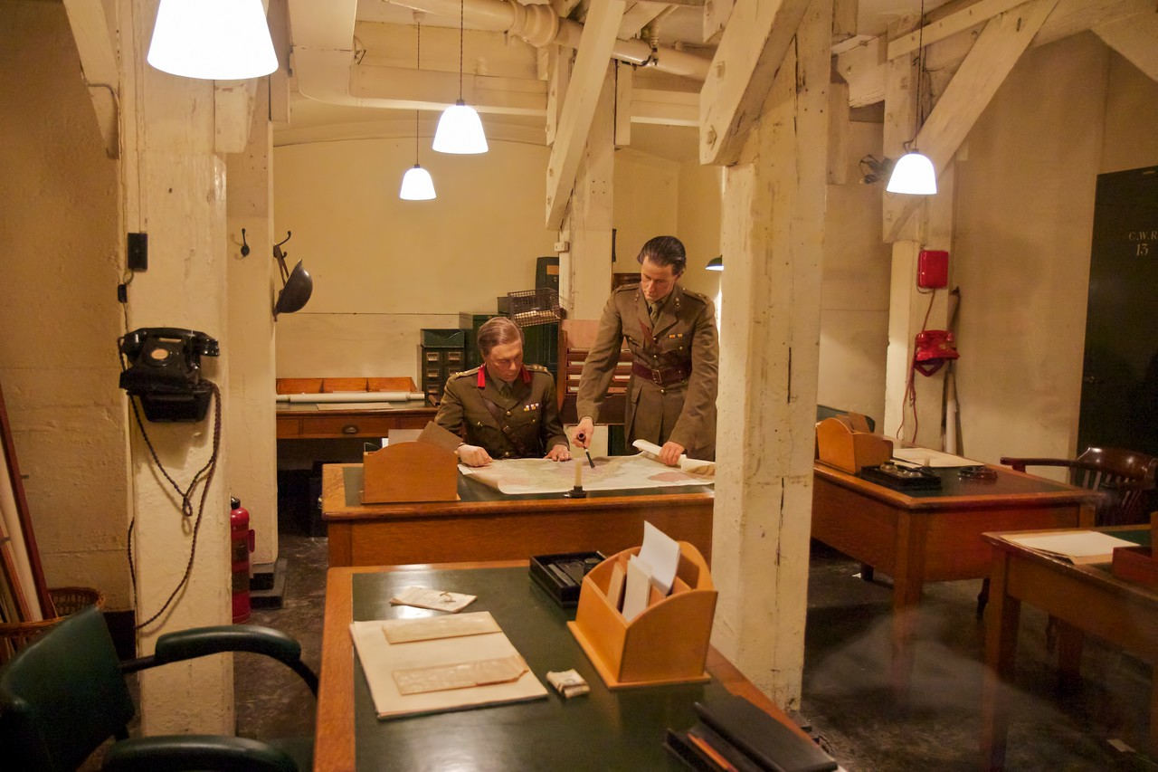 """Churchill War Rooms Museum <br><br> The Churchill War Rooms is a fascinating museum in London, consisting of the Cabinet War Rooms and the Churchill Museum. The war rooms are an underground complex that housed the British government during World War II. During the war, the rooms were in constant use by officers responsible for producing daily information for the King, Prime Minister, and the military Chiefs of Staff.  <br><br> The Cabinet War Rooms are located in the Treasury Building in the Whitehall area of Westminster not far from the Parliament Buildings. They became operational in August 1939, days before the German invasion of Poland, and remained in operation until August 1945. <br><br> The War Rooms were fortified on several occasions during the German bombing of London. However, a recurring theme of the museum was that it was not all that secure. A sign on the wall of the museum reads:  <br><br> This was the Global Hub of Information on the War <br><br> The Government's Secret Bomb Shelter <br><br> An East Target that was Never Hit <br><br> The rooms were preserved after the war. A limited number of people could tour the rooms until they were opened to the public in 1984. The museum was reopened in 2005 following a redevelopment as the Churchill Museum and Cabinet War Rooms, now simply called the Churchill War Rooms.   <br><br> See the<a href=""""http://www.iwm.org.uk/visits/churchill-war-rooms"""">Churchill War Rooms website</a> for more detail."""