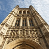 "Victoria Tower, Palace of Westminster <br><br> The Victoria Tower, named after Queen Victoria, is the tallest tower in the Palace of Westminster at 325 feet. The tower was originally designed as a Royal entrance. It is now home to the Parliamentary Archives. Architect Charles Barry designed the tower with rich carvings and sculpture with statues of patron saints of England,Scotland, Whales, a life-sized statue of Queen Victoria, and allegorical figures of Justice and Mercy.  <br><br> The gateways of the tower were built wide enough to allow the Queen's coach to drive through for State Openings of Parliament. The base of the tower is the Sovereign's Entrance, which is used by the Queen whenever entering the Palace. By tradition, this route is the only one the Sovereign is allowed to take when he or she comes to the House of Lords.  <br><br> The Victoria Tower is one part of the Palace of Westminster. The Palace is in perpendicular Gothic style, popular in the 15th century. The current buildings replaced Parliament buildings destroyed by the Great Fire of 1834. The fire was started when the Clerk of Works thought that burning obsolete wooden accounting tally sticks in two under floor stoves in the basement of the House of Lords would be a safe place to dispose of them; it was not.  <br><br> In 1836, Charles Barry was selected in a competition to design the new Palace. Construction started in 1840. Barry estimated that it would take six years to complete his vision; instead it took more than 30 years. Barry was assisted by Augustus Welby Pugin, a young architect and draftsman. Some believe that Pugin should receive greater credit than Barry for the design of the Palace.   <br><br> See the<a href=""http://www.parliament.uk/about/living-heritage/building/palace/"">Parliament website</a> for more detail."
