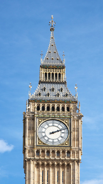 Big Ben, Elizabeth Tower, Palace of Westminster <br><br> Big Ben is one of the most recognizable buildings in the world. The dials are about 23 feet in diameter and made from cast iron. Each dial contained 312 separate pieces of pot opal glass, which has an opaque finish.  <br><br> A competition was held in 1846 to decide who should build the clock; however, the project was not completed until 1859. One reason for the delay was demanding standards for the clock put in place by Astronomer Royal Sir George Airy, who insisted that the first stroke of each hour must be accurate to within one second and the clock's performance must be telegraphed twice a day to Greenwich Observatory. Edmund Beckett Denison, a barrister and a gifted amateur clockmaker was appointed to design the clock. Denison made many refinements to the clock including inventing the Double Three-legged Gravity Escapement. This was a revolutionary mechanism that enhanced the clock's accuracy by ensuring that its pendulum was unaffected by external factors such as wind pressure on the clock's hands. This invention has been used in many clocks worldwide.  <br><br> The clock was installed in April 1859. However, the clock did not work because the cast-iron minute hands were too heavy. They were replaced by lighter copper hands and began keeping time in May 1859.  <br><br> The Great Bell in the tower is known as Big Ben. Two candidates exist for the name's origin: Sir Benjamin Hall, the First Commissioner for Works from 1855-1858 or Ben Caunt, a champion heavyweight boxer of the 1850s, with the first candidate more likely.  <br><br> The first bell that was cast cracked. The second bell was lighter, but took 30 hours to winch to the top in October 1858. The bell rang for the first time in July 1859 but cracked in September 1859. In 1863 a solution was found by turning the bell a quarter turn so the hammer would hit in a different spot. Also the hammer was replaced by a lighter version and a small square was c