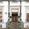 """Abbey Road Studios, London <br><br> The Beatles recorded almost all of their albums and singles between 1962 and 1970 at Abbey Road Studios. The building is a nine-bedroom Georgian townhouse built in the 1830s. The building was acquired by the Gramophone Company in 1931 and converted into studios. One of the most famous early artists to was Paul Robeson who recorded at the studio from 1931 to 1939. <br><br> In addition to the Beatles, Pink Floyd recorded most of their albums at Abbey Road, from the late 1960s to the mid-1970s. John Williams and the London Symphony Orchestra used the studios to record the scores of five Star Wars films. All three of the film scores for The Lord of the Rings were mixed at the studios. See <a href=""""http://en.wikipedia.org/wiki/Abbey_Road_Studios"""">Wikipedia</a> for more detail. <br><br> Abbey Road Studios is still an active studio and draws many Beatles fans; many cross the famous zebra crossing, much to the chagrin of busy auto traffic.  The studio has a <a href=""""http://www.abbeyroad.com/Crossing"""">webcam showing the crossing,</a> allowing viewers to search and download clips from the previous day. The wall and gate facing the studio are filled with graffiti and painted over periodically."""