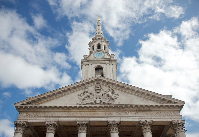 "Saint Martin-in-the-Fields  <br><br> Saint Martin-in-the-Fields is an Anglican church at Trafalgar Square in London. The church is dedicated to Saint Martin of Tours. Martin, after a career in the Roman army, entered the Christian Church and became Bishop of Tours. He is remembered for an act of generosity by cutting his cloak in two to give to a beggar clad in rags.  <br><br><a href=""http://www.stmartin-in-the-fields.org/about/history/"">According to the church website</a> there is no official reference to a church on the site of Saint Martin's until Norman times, when in 1222 a dispute was recorded between several parties on the Bishop's authority over the church.  <br><br> In around 1542, Henry VIII, ""…built a new church and extended the parish boundaries to keep plague victims from being carried through his palace. This was enlarged in 1607 at the cost of Prince Henry, the son of King James I. This church was pulled down in 1721 to be replaced by the current building."" <br><br> James Gibbs designed the present church and was completed in 1726. Gibbs drew on the work of Christopher Wren (architect of over 50 churches in London including Saint Paul's Cathedral) but departed from Wren's practice in his integration of the tower into the church, <a href=""http://en.wikipedia.org/wiki/St_Martin-in-the-Fields"">according to WIkipedia.</a> The design was criticized at the time but has established itself as a landmark and copied widely in the U.S. It has become one of the most significant ecclesiastical buildings in the English-speaking world, according to the church website. <br><br> The church is one of the most famous churches in London, according to Wikipedia. The church is the parish of the Royal Family, 10 Downing Street, and the Admiralty. The church flies the White Ensign of the Royal Navy rather than the Union Flag."