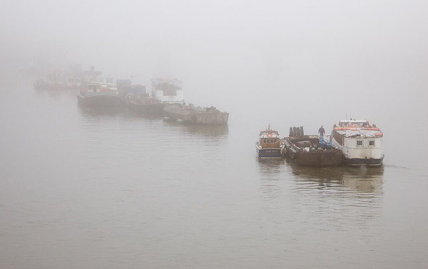 Boats in the fog on the River Thames