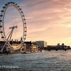 London Eye lit by evening sun