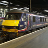 90021 is seen on the stops at London Euston after arriving with the sleeper service from Inverness on 21/01/12