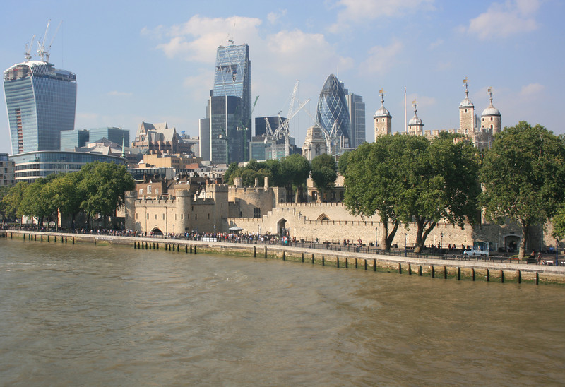 Ancient and Modern, Tower of London and City skyscrapers.