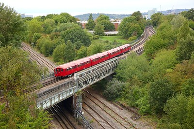 1938 Tube Stock, Train 746 working 0850 Ealing Common Depot to Harrow-on-the-Hill heads over the Central line and Greenford mainline at Park Royal on the 9th September 2018