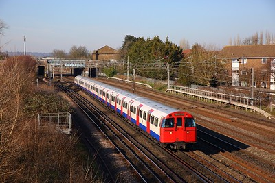 3231 leads Train 24 with a southbound Bakerloo line train to Elephant & Castle at South Kenton on the 24th February 2019