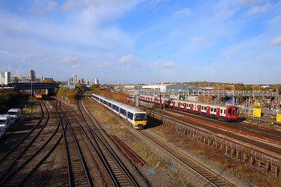 165038 on the 2C25 0915 Aylesbury Vale Parkway to London Marylebone passes a Southbound Metropolitan line train and 66771 at Neasden South junction on the 8th November 2018