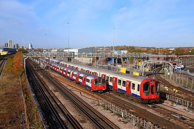 S Stock 21082 works a Metropolitan Southbound train to Aldgate passing 96123 with a southbound Jubilee line train to Stratford at Neasden depot on the 8th November 2018