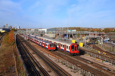 S Stock 21082 works a Metropolitan Southbound train to Aldgate passing 96123 with a southbound Jubilee line train to Stratford at Neasden depot on the 8th November 2018 1
