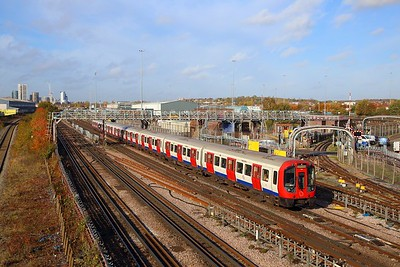 S Stock 21104 works a southbound Metropolitan line train at Neasden depot on the 8th November 2018