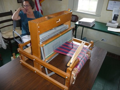 Weaving and other crafts on display, come try weaving on our loom!