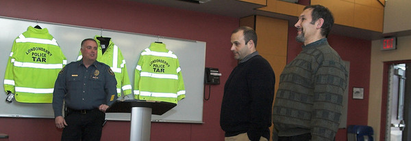 Chuck Bolianites and Michael Karras of Charles George Companies Present LPD with New Jackets
