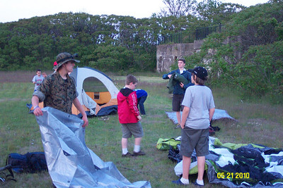 Troops setting up camp. Note the structure in the background which is part of Fort Standish.